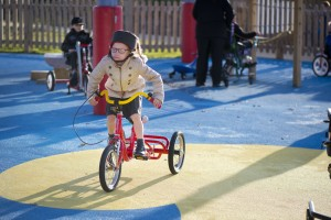 Child on a bike in the playground